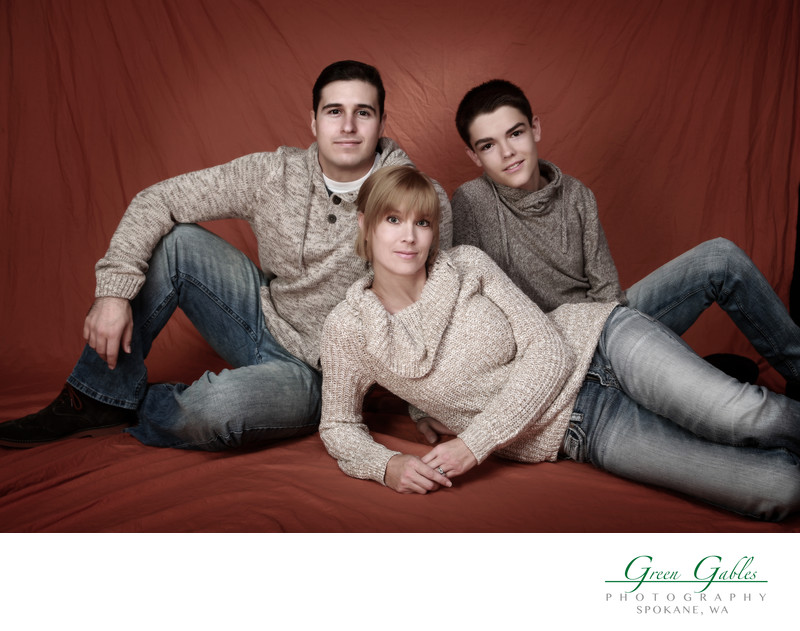 family of three casual pose in Studio