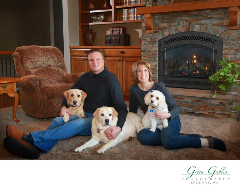 couple in their home with their dogs