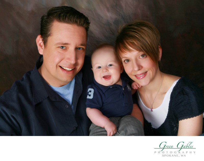 family of three in candid studio