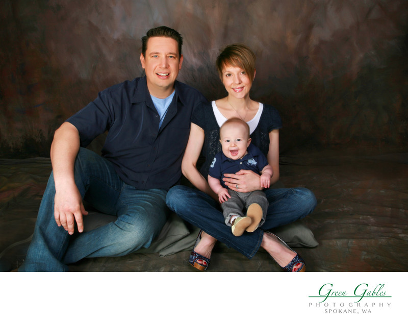 family portrait of three in studio