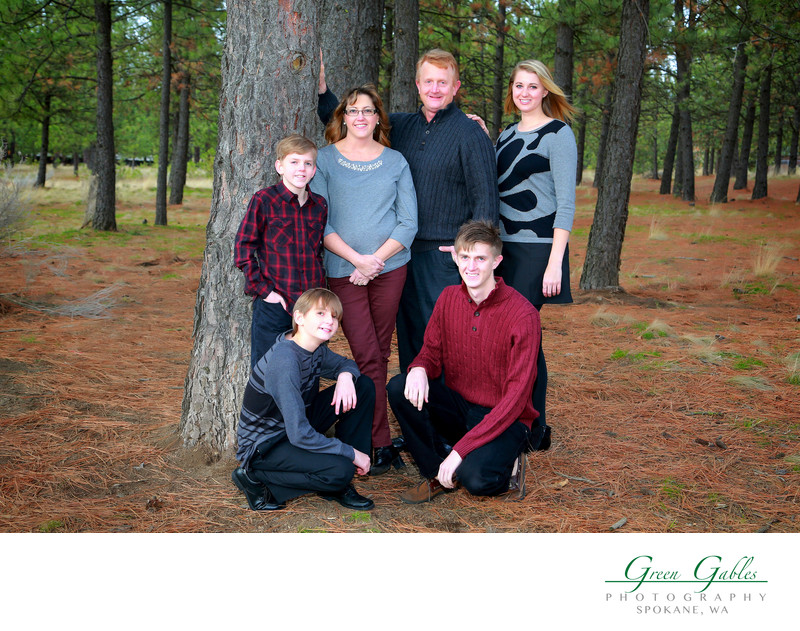 fun family portrait in the woods