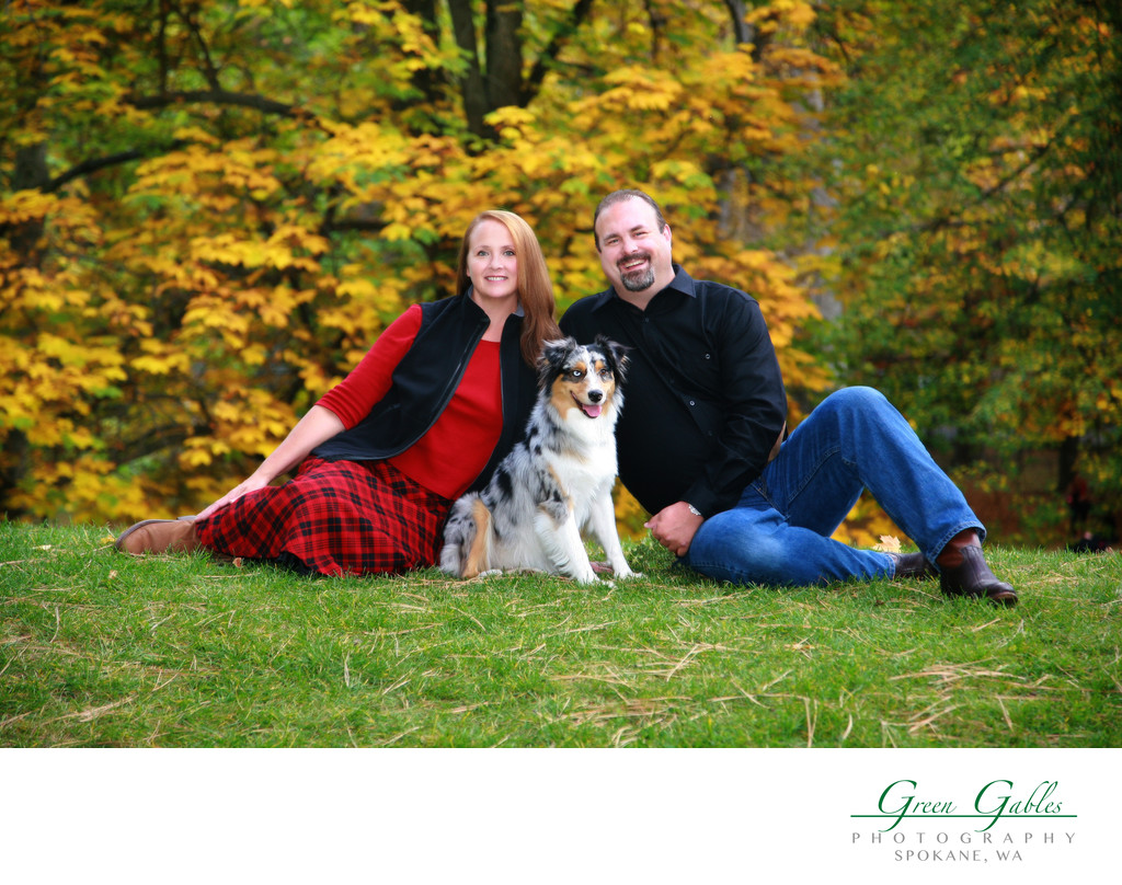 couple portrait in the park with their dog
