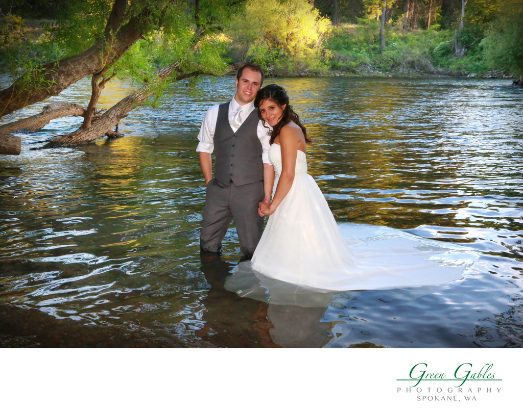 bride & groom wading in the water