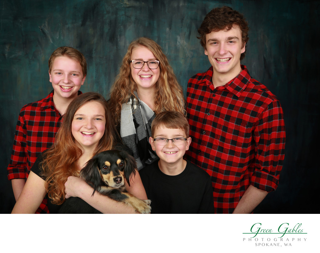 siblings with the dog in studio