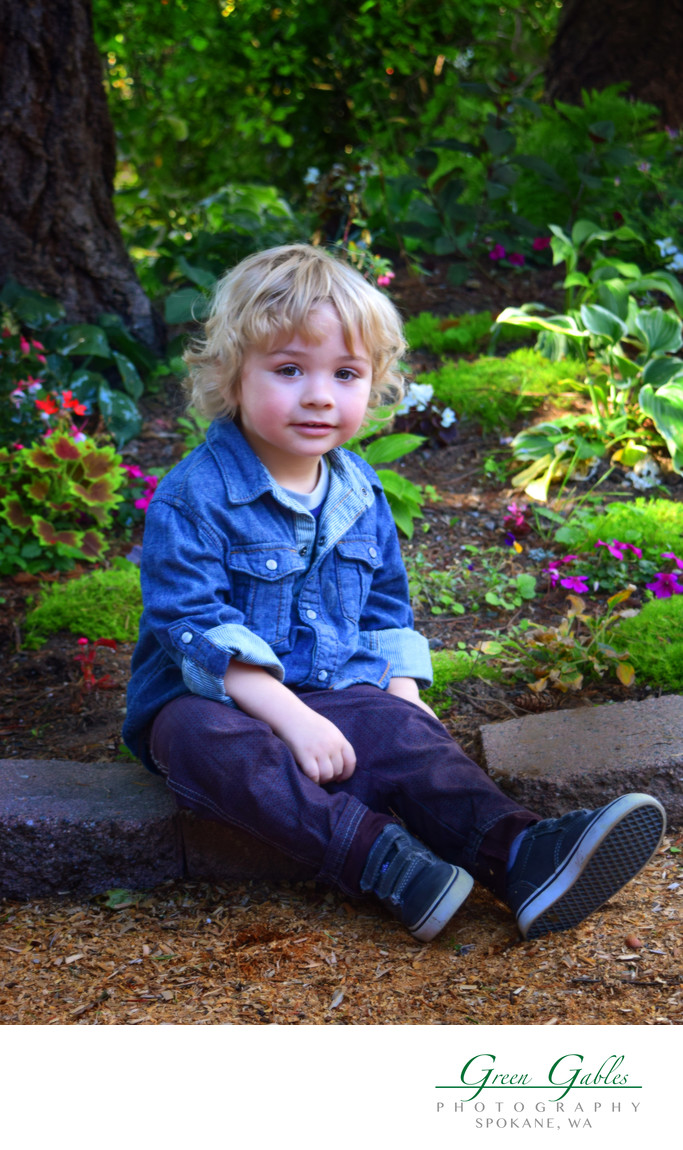in grandmas garden, cute little boy