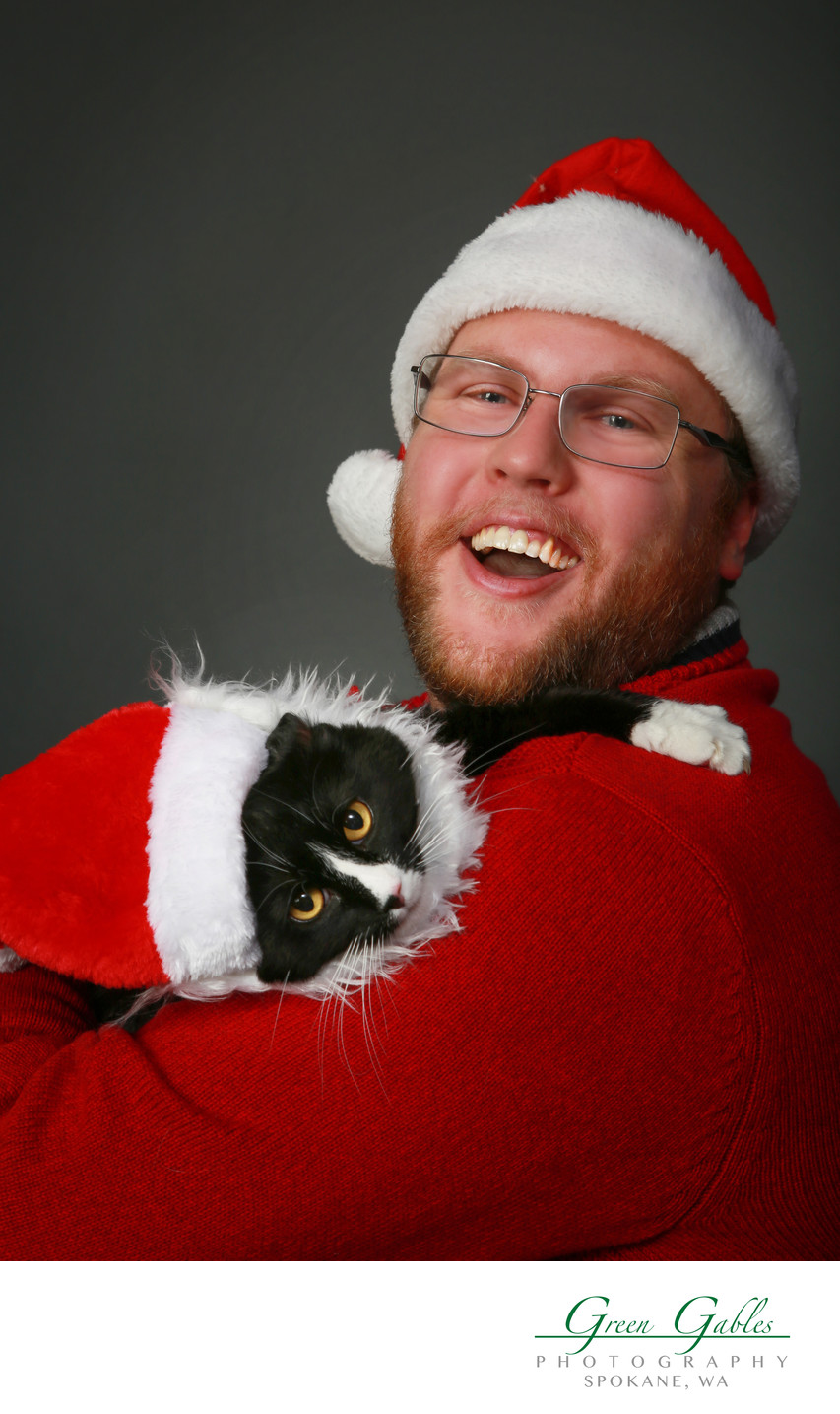 man with his Santa cat