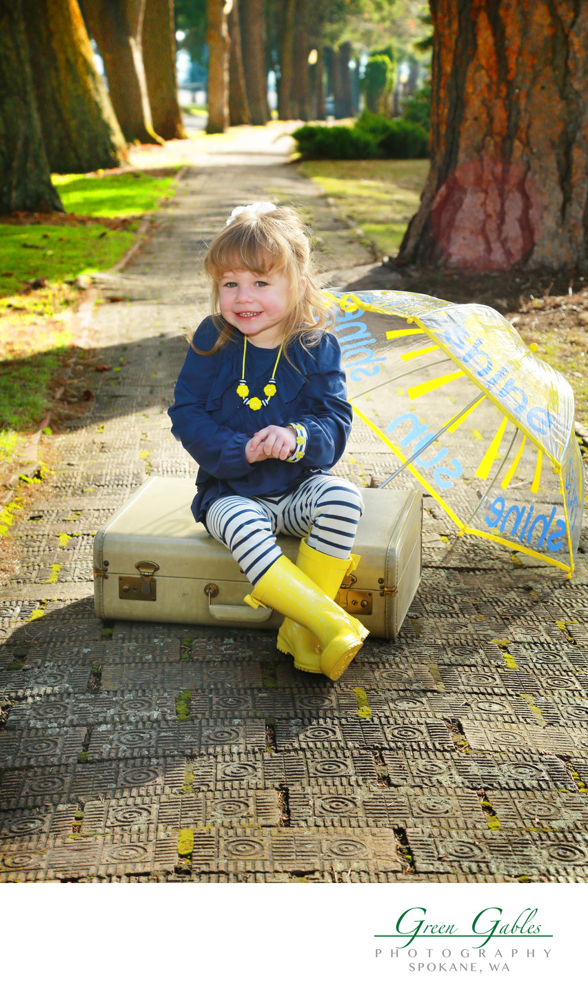 location portrait of little girl and umbrella