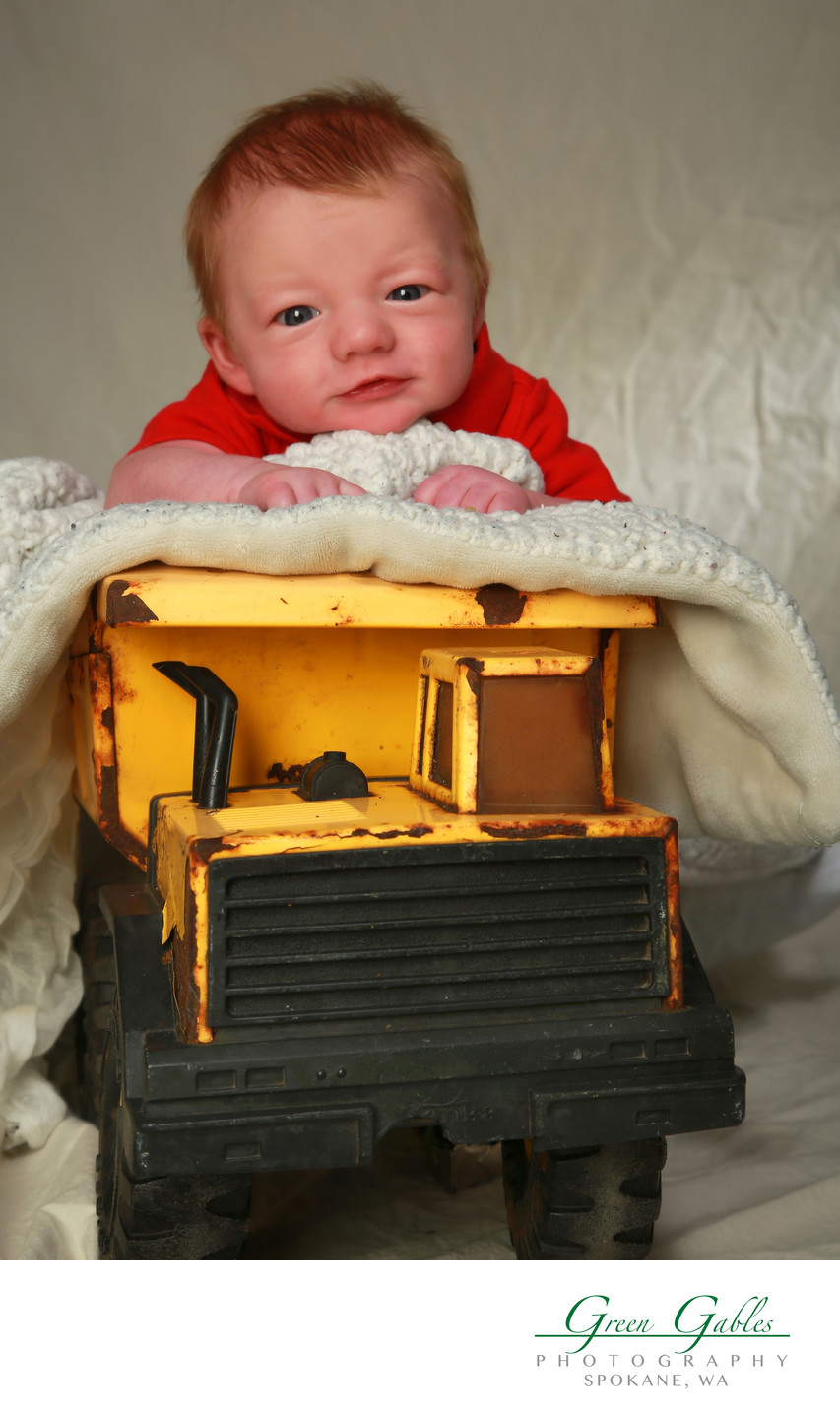 baby boy with dads old truck