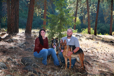 couple in the woods with their 2 dogs