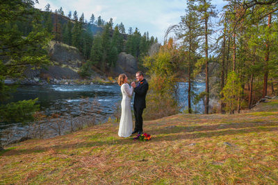 Spokane river with bride & groom