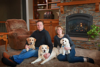 In home couples portrait with the three dogs