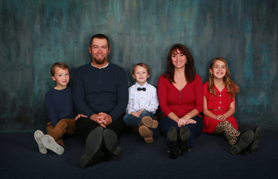 casual studio portrait of family of five