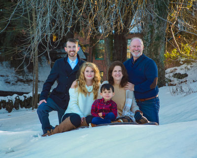 location family in the snow
