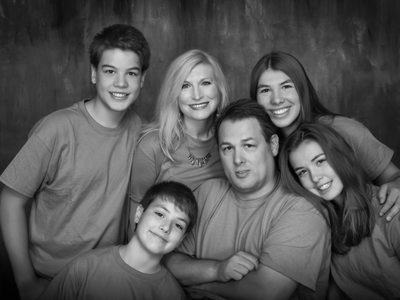 family group in studio, black and white, fun