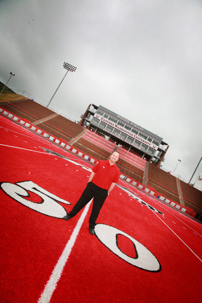 EWU Football Coach on 50 yard line