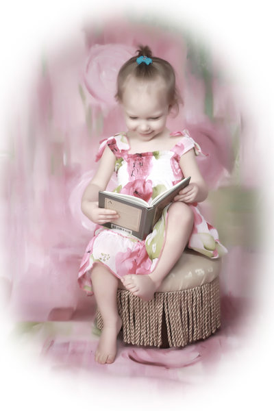 little girl, candid, reading and having fun