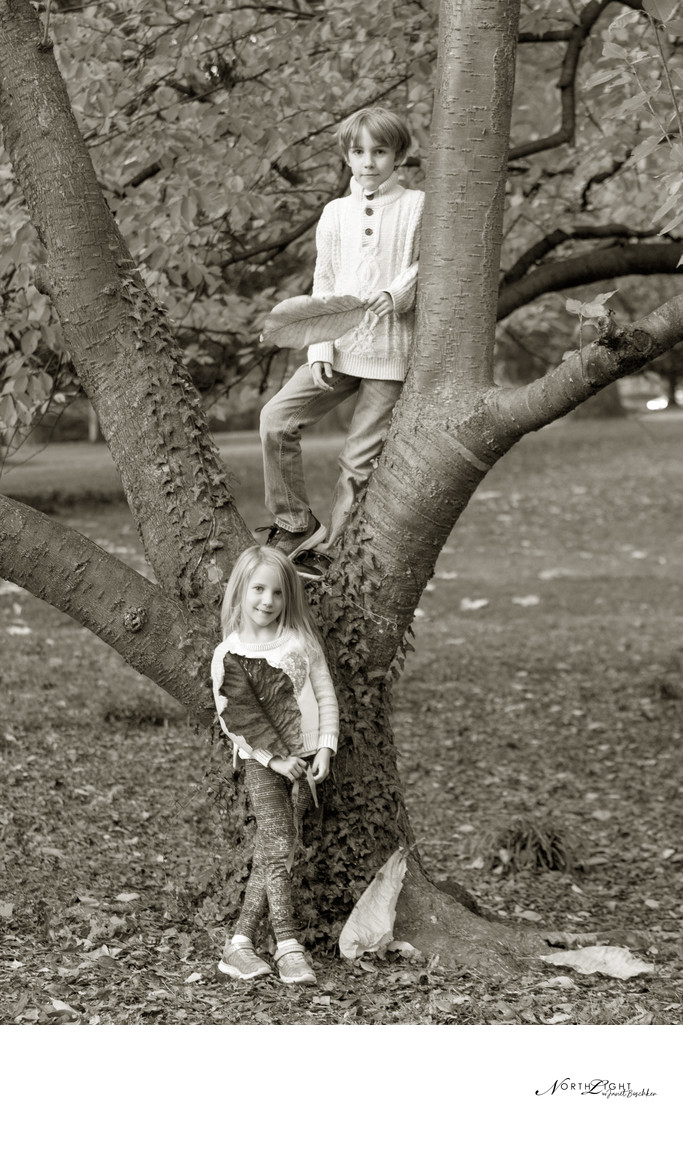 Boy and Girl Photograph in Tree at Park B&W