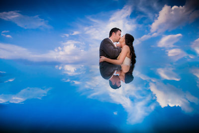 Bride and Groom Embrace in Clouds, Grandover Resort, NC