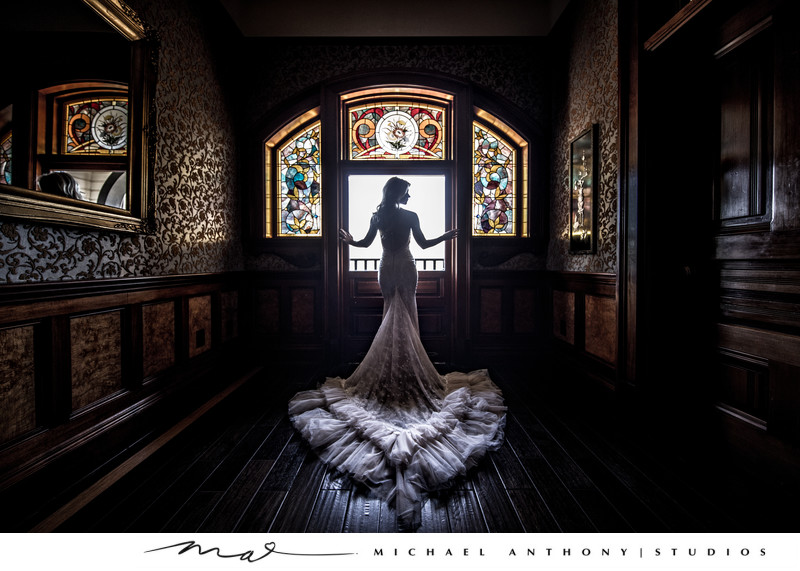 A Bride in front of stained glass at Newhall Mansion