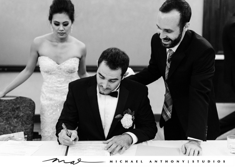 A Groom Signing The Marriage License at Hyatt Valencia