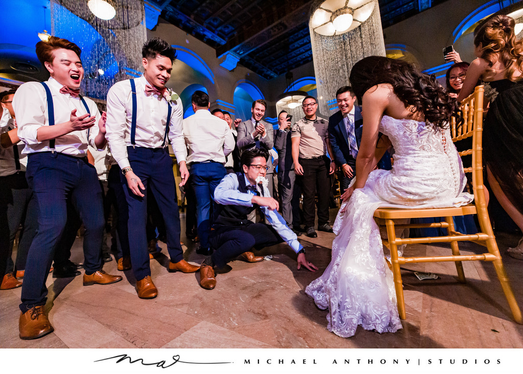 Fun Images of a Garter Toss at Majestic Downtown Wedding