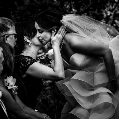 Bride Kisses Mom at Ceremony