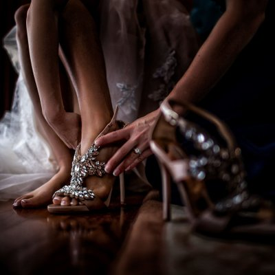 Bride puts on Shoes Before Wedding