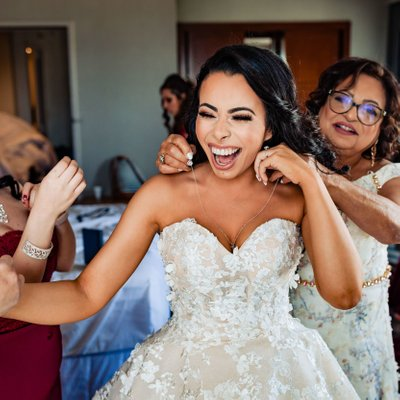 Bride Laughs While Getting Ready