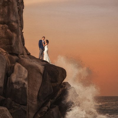 Grand Solmar Land's End Resort Wedding: Bride and Groom Standing on Cliffs with Waves