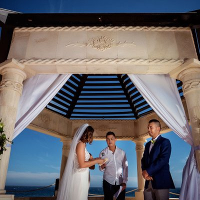 Grand Solmar Land's End Resort Wedding: Bride Reading Vows During Ceremony