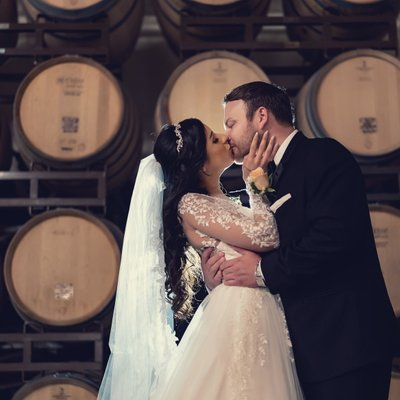 Callaway Winery Wedding: Bride & Groom in Barrell Room