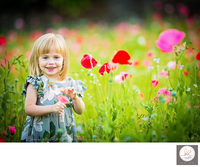 Little girl in the poppies