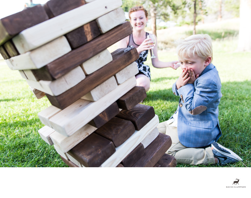 Boy Topples Jenga Game at 320 Guest Ranch in Montana