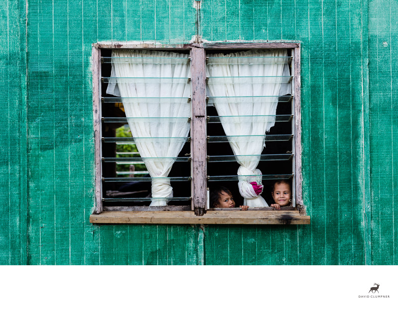 Kids Look Out Window from House in Nomuka Tonga