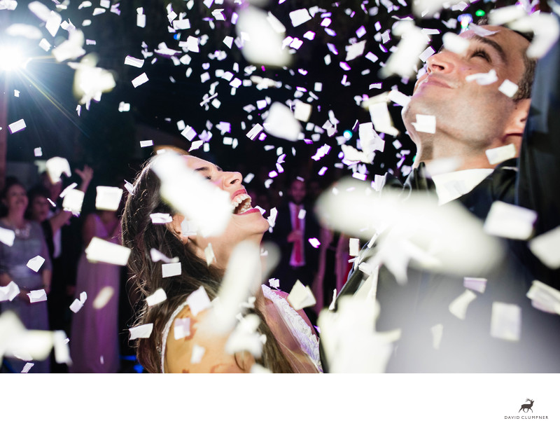 Bride and Groom under Falling Confetti