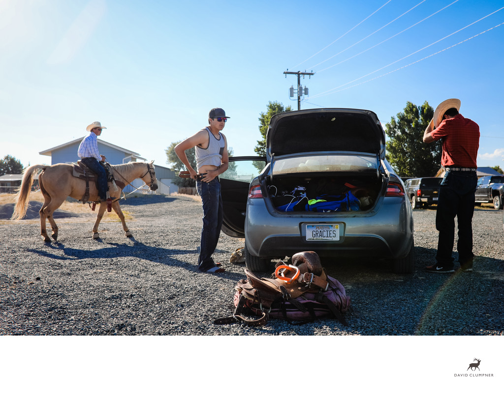 Saddle Bronc Riders Get Dressed in Parking Lot