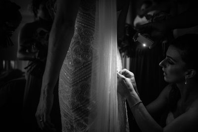 Alterations to bride's dress by flashlight in Maui