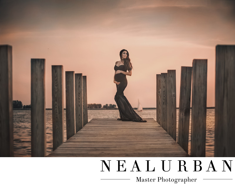 buffalo maternity photography at waterfront by the water pier with sail boat