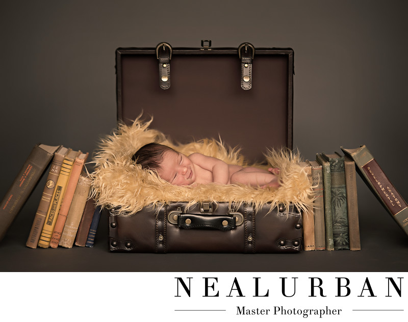 buffalo baby newborn photography ideas in suitcase boy books