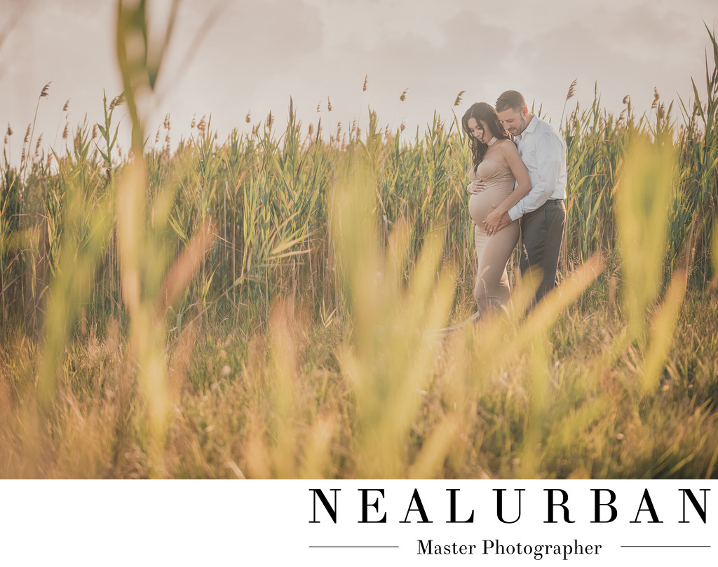 buffalo baby bump maternity with tall grass at tifft