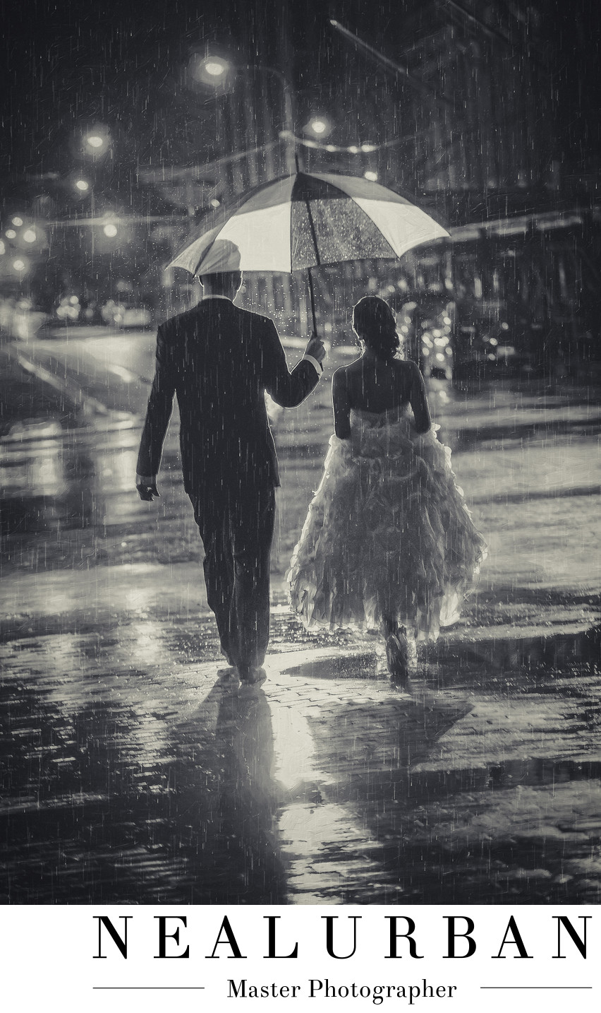 best buffalo wedding photographers bride and groom in the rain