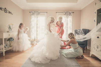 bride getting ready with mother flower girl moh dress