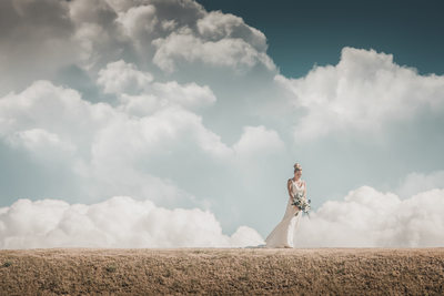 fort niagara wedding bride clouds wind dress flowing