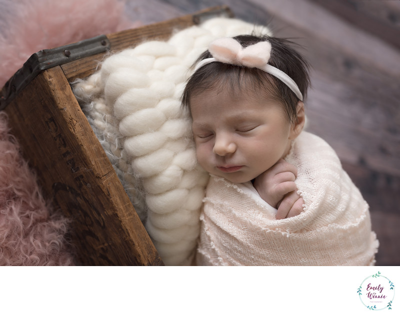 Emily Winnie Photography- Baby sleeping in crate