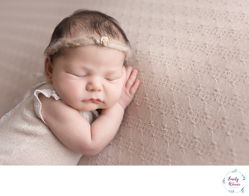 Emily Winnie Photography- Newborn resting on taupe blanket