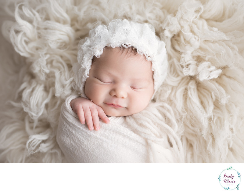 Emily Winnie Photography-baby in white frilly bonnet
