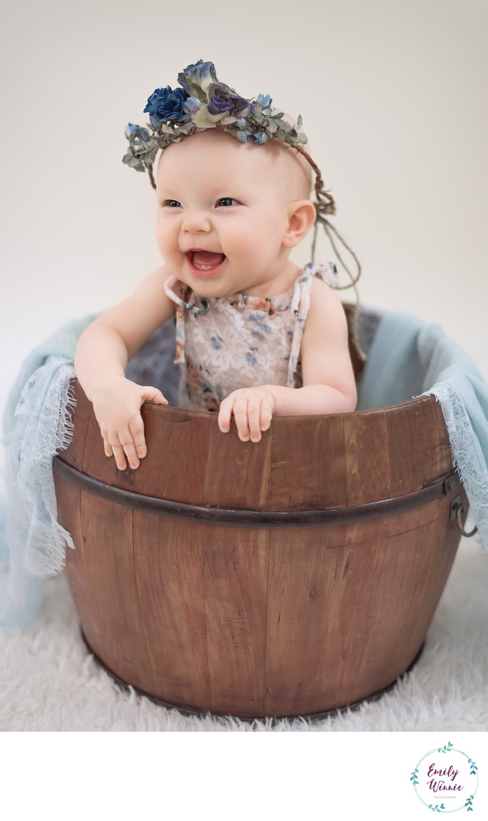 Baby milestone session-baby in bucket in Los Angeles