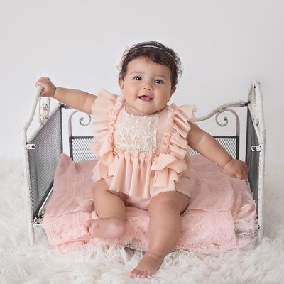 Baby girl on vintage Bed