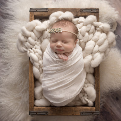 Emily Winnie Photography-Baby in cream resting in crate