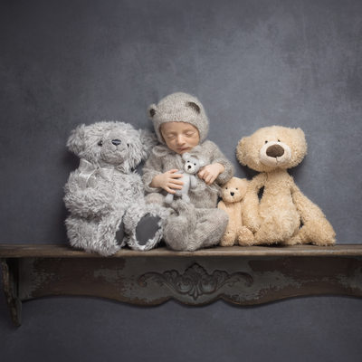 Emily Winnie Photography- Baby with teddies on shelf